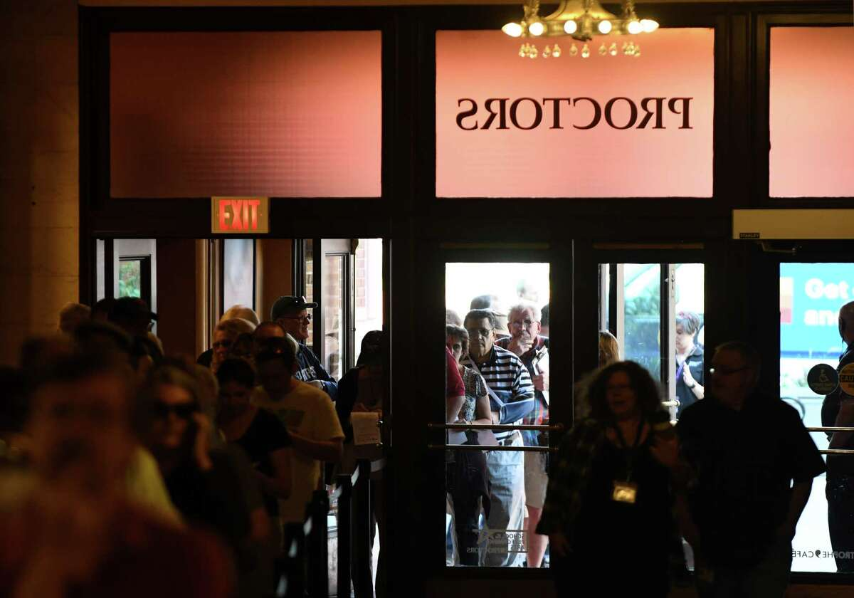 """People stand in a line that stretched around the block to purchase tickets for """"Hamilton"""" at Proctors on Monday morning, June 24, 2019, in Schenectady, N.Y. (Will Waldron/Times Union)"""
