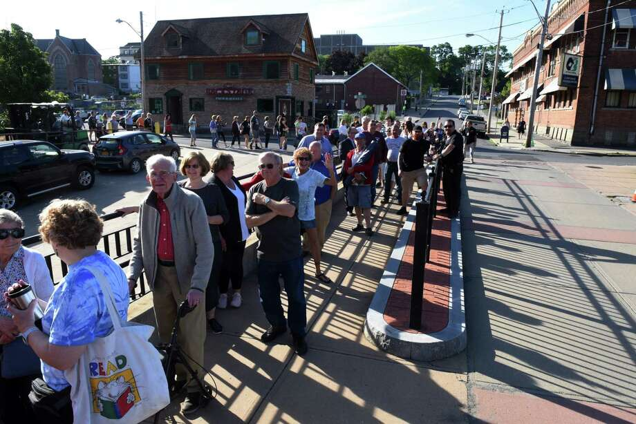 "People stand in a line that stretched around the block to purchase tickets for ""Hamilton"" at Proctors on Monday morning, June 24, 2019, in Schenectady, N.Y.  (Will Waldron/Times Union) Photo: Will Waldron, Albany Times Union / 20047293A"