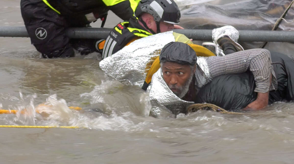 The Houston Fire Department high water rescue team get Terry Lewis out of the flooded Brays Bayou near MacGregor Way Monday, June 24, 2019, in Houston.