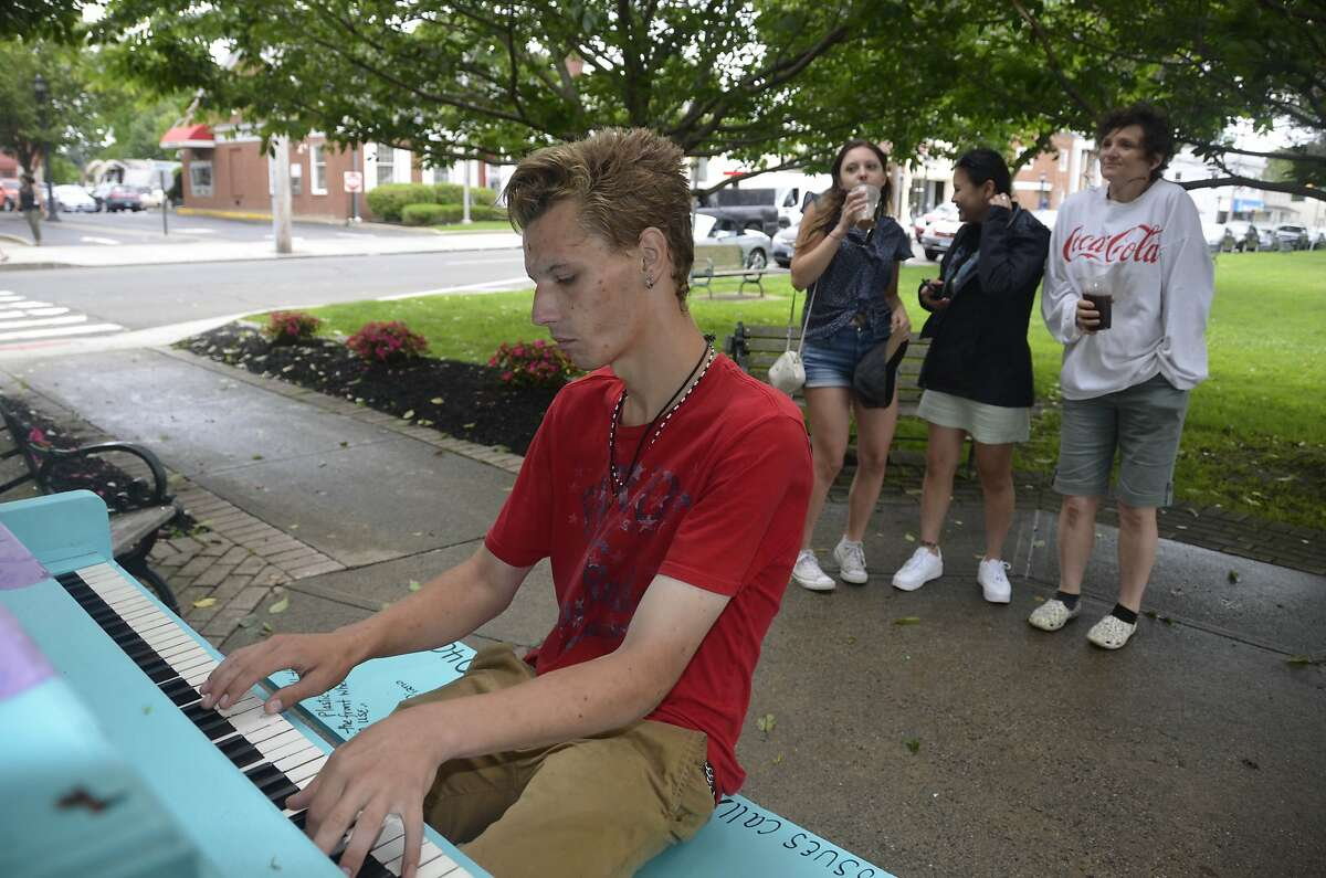 People could be found all around Milford playing piano, guitar and making music in other manners on Friday, June 21, 2019, Make Music Day.Andrew Bestercy was walking downtown when he spotted the piano that was painted and placed on the Green by local piano technician Gina Bonfietti. So he started to play, and quickly drew a small crowd.