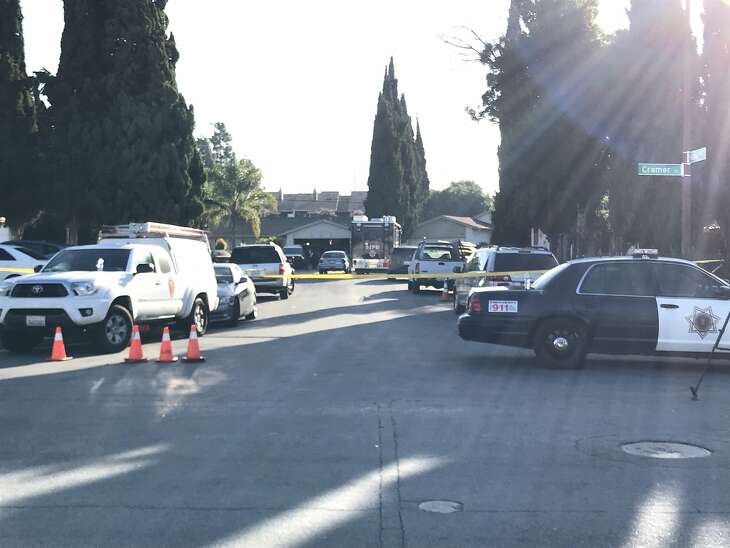 Crime scene tape blocks off the cul-de-sac of Cramer Circle and Habbits Court in San Jose, where four people died in a murder-suicide Sunday night.