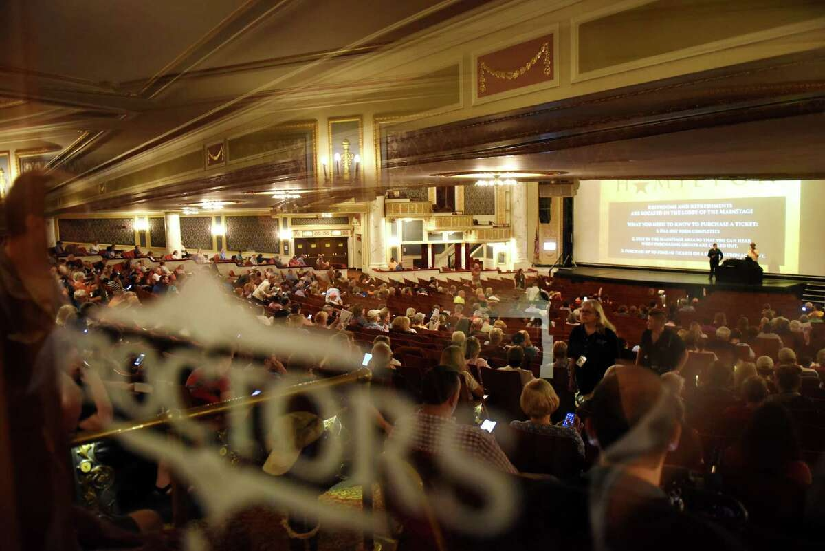 """Ticket buyers wait for their chance to purchase tickets to see """"Hamilton"""" at Proctors on Monday morning, June 24, 2019, in Schenectady, N.Y. (Will Waldron/Times Union)"""