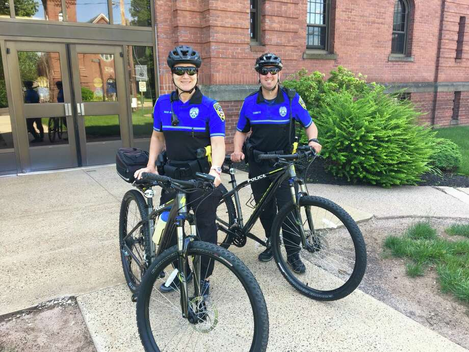 Wallingford police Officers Megan Baur and Henry Cadett. Photo: Wallingford Police Department