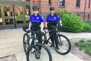 Wallingford police Officers Megan Baur and Henry Cadett.