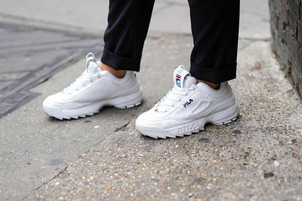 LONDON, ENGLAND - JUNE 08: A guest wears white FILA sneakers shoes, during London Fashion Week Men's June 2019 on June 08, 2019 in London, England. (Photo by Edward Berthelot/Getty Images)