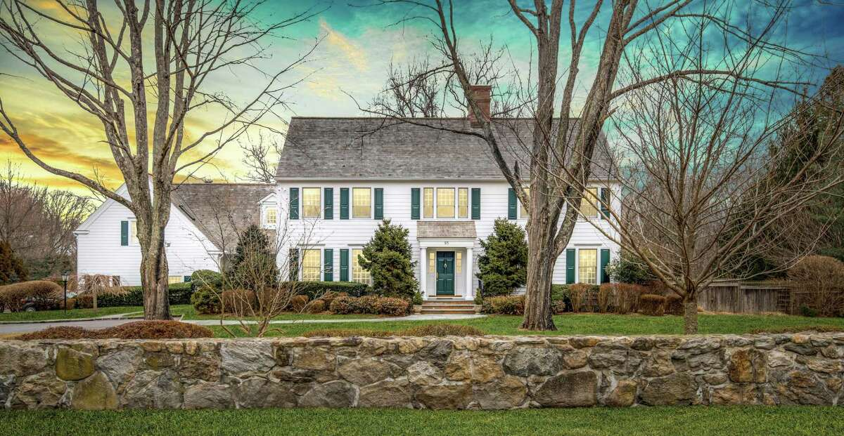 The classic center hall colonial house at 95 Kettle Creek Road has 14 rooms and 9,506 square feet of living space in the center of Weston.