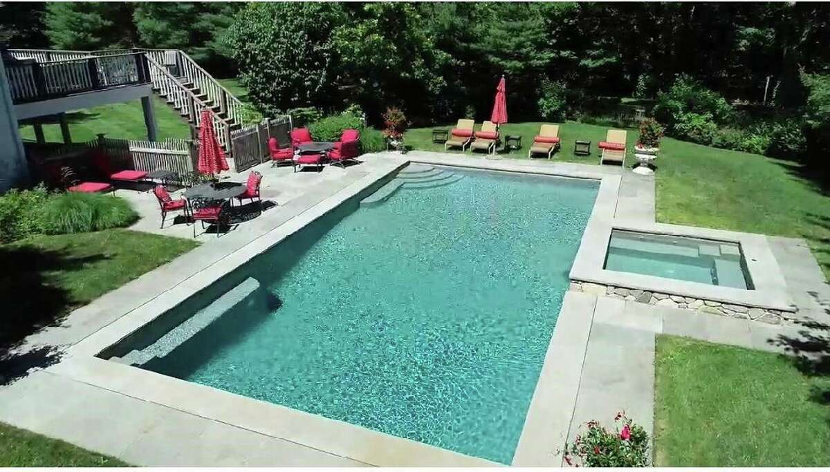 Among this home's many features are the heated Gunite in-ground swimming pool and spa, large raised deck and bluestone patios.