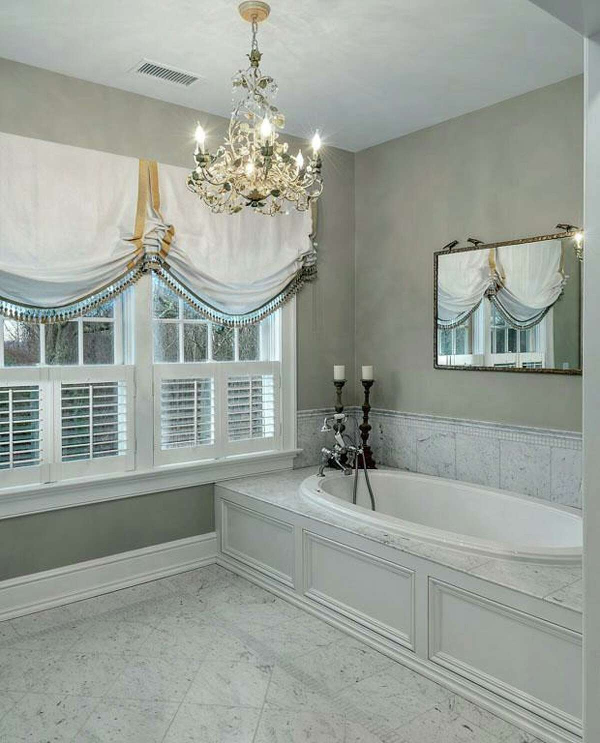 The master bath has a steam shower and jetted tub.