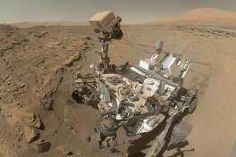 In a composite by The New York Times, NASA's Curiosity rover in an April 2014 self-portrait. Curiosity found methane on Mars, offering the possibility of life under the surface. (NASA via The New York Times) -- NO SALES; FOR EDITORIAL USE ONLY WITH STORY SLUGGED SCI-DEEP-BIOSPHERE BY KENNETH CHANG. ALL OTHER USE PROHIBITED.