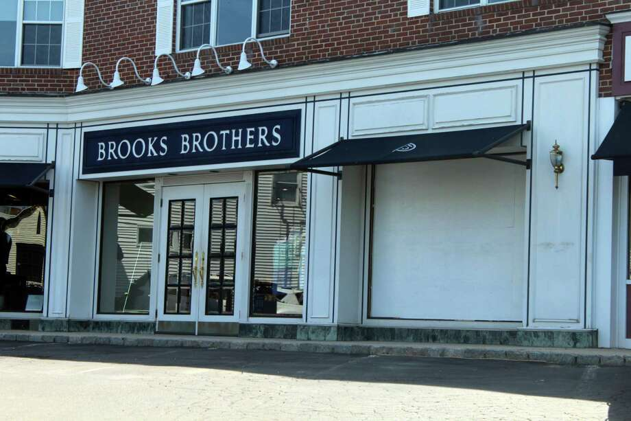 Brooks Brothers on Main Street has boarded up their show window after a car hit it Sunday night. Taken June 24, 2019 in Westport, CT. Photo: Lynandro Simmons/Hearst Connecticut Media