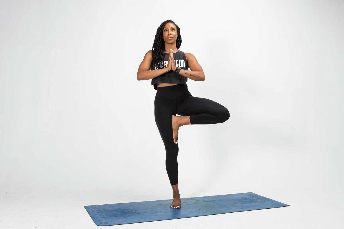 Local yoga instructor Alicia Tillman demonstrates the Tree pose.
