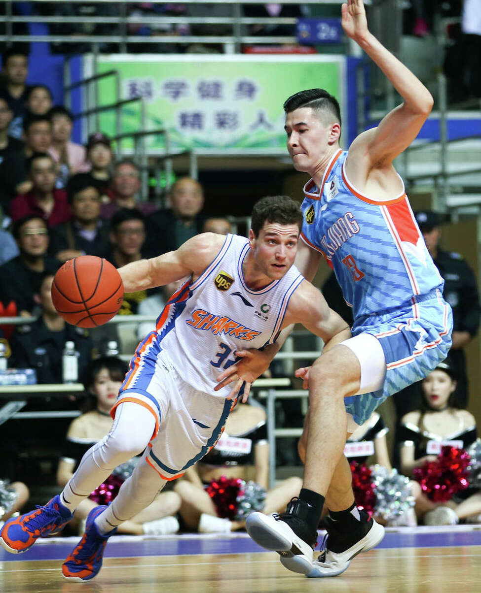 Jimmer Fredette of Shanghai Bilibili Sharks drives the ball during the 2018/2019 Chinese Basketball Association (CBA) League 13th round match between Shanghai Bilibili Sharks and Xinjiang Guanghui Flying Tigers at Pudong Yuanshen Gymnasium on November 18, 2018 in Shanghai, China.
