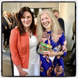 Chronicle Editor-in-Chief Audrey Cooper (left) celebrates the newspaper career of Leah Garchik. June 18, 2019.