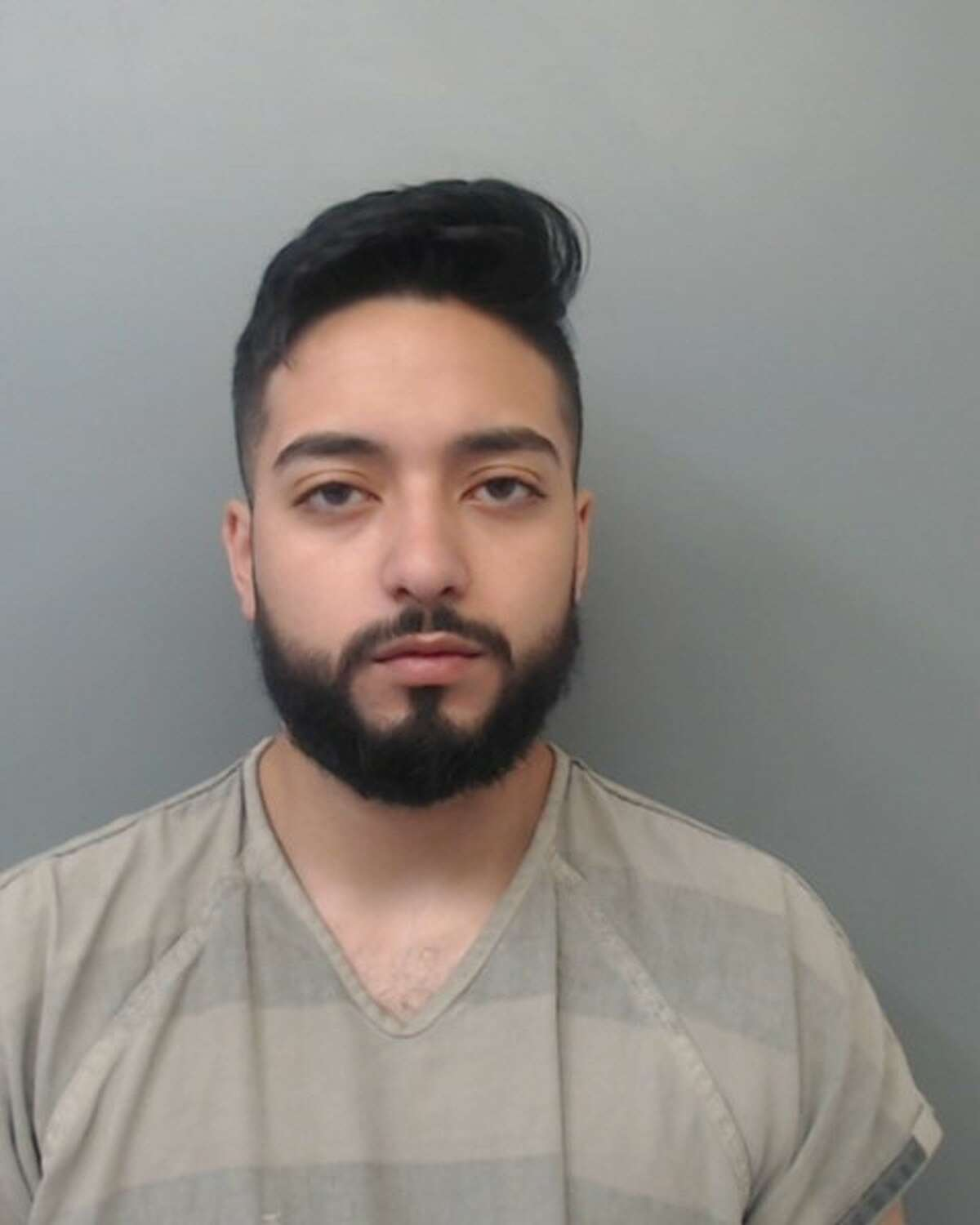 Isaiah Camacho, 21, was arrested and charged with possession of a controlled substance and possession of marijuana.