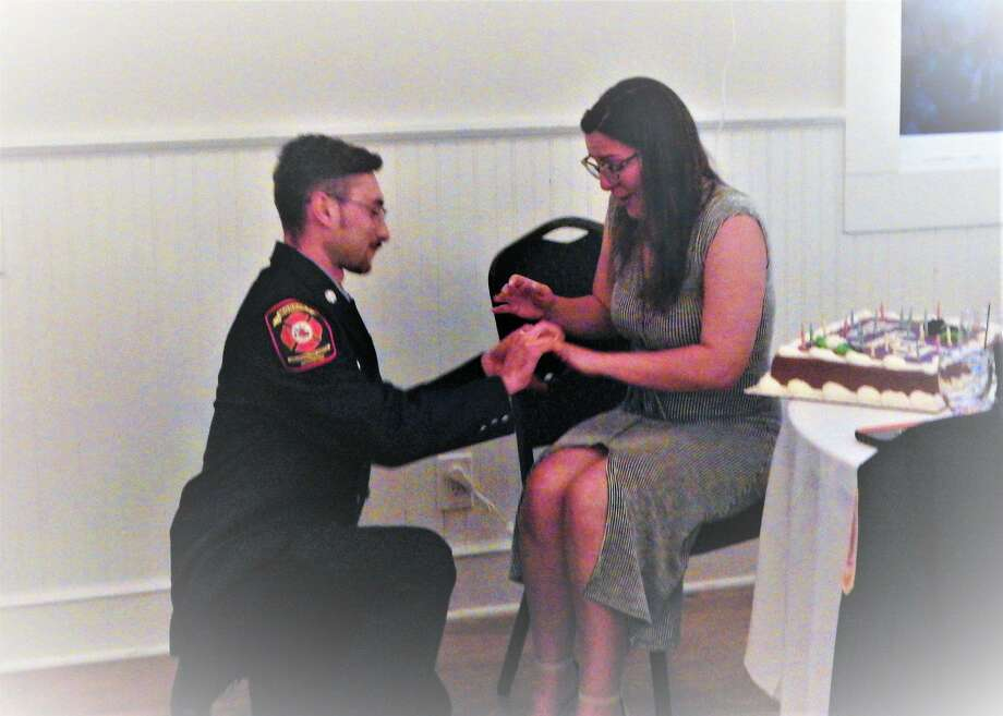 According to a post on the Monroe Volunteer Fire Department Facebook page, firefighter Mike Provenzano proposed to his girlfriend, Allison Mostowy, at the annual awards banquet and recognition ceremony, which took place June 22, 2019. Photo: Contributed / Monroe Volunteer Fire Department Facebook Page