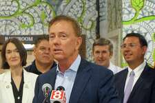 Gov. Ned Lamont spoke to reporters at Tribus Beer Company in Milford, Conn. on Monday June 24, 2019. He was joined by Democrat and Republican state lawmakers who applauded his signature on a bill increasing the amount of beer craft breweries can sell on site.