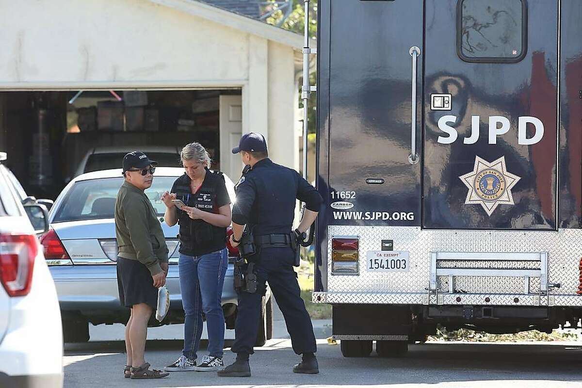 Emergency responders interview a person on Habbitts Court as they investigate the scene of a multiple shooting on Monday, June 24, 2019 in San Jose, Calif. At least five people - including the suspect - have died following what San Jose police are calling a quadruple murder-suicide, which included a standoff that started Sunday night and ended early Monday morning.