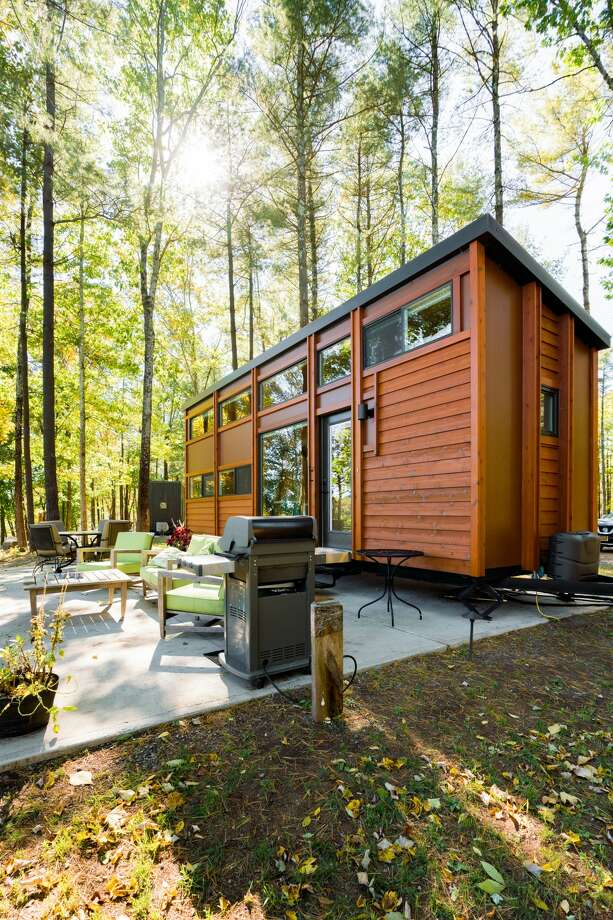 """South Cairo, the Catskills.Five guests, one bedroom, one bed, one bath. """"Tiny house perched over Catskill Creek. ... The compact interior offers a neatly arrayed, wood-paneled layout featuring soaring ceilings on the main floor, and an extra sleeping loft."""" $225 per night. See website. Photo: Airbnb"""