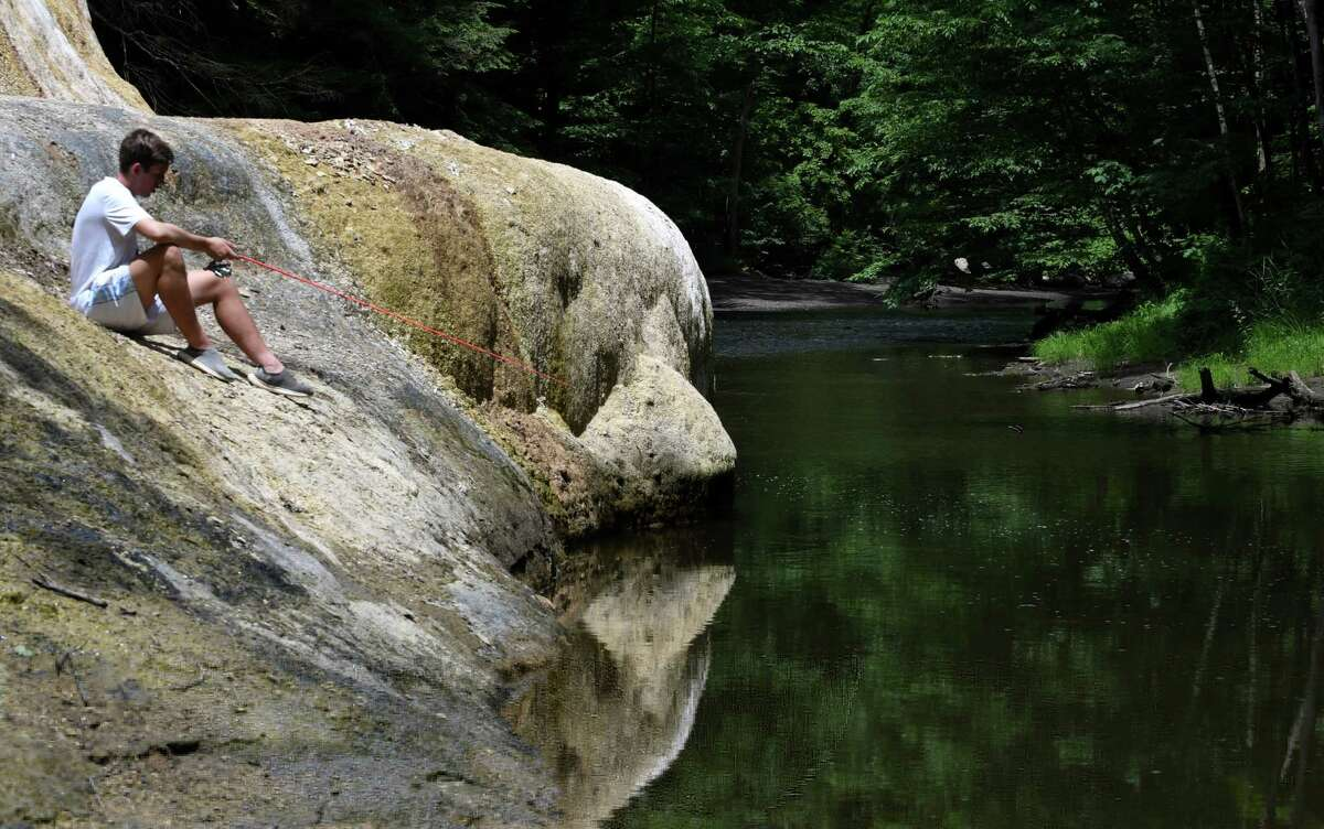 Cam Steuer of Saratoga Springs waits for a bite while fishing at Geyser Creek in Saratoga Spa State Park on Monday, June 24, 2019, in Saratoga Springs, N.Y. (Will Waldron/Times Union)