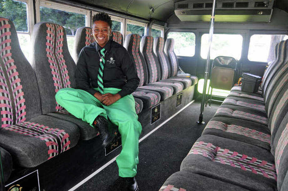 Price-Less Transportation owner La Tisha Price sits inside the company's bus that will take workers to and from the Gateway Commerce Center. Price-Less also has a chauffeur service.