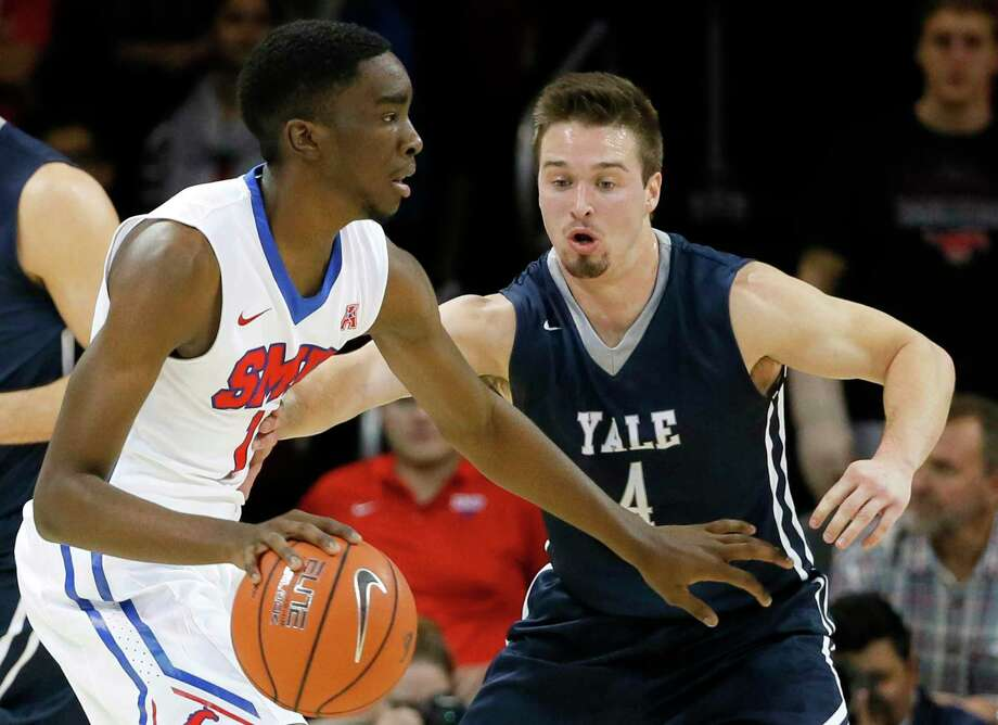SMU guard Shake Milton (1) moves the ball around the perimeter as Yale's Jack Montague (4) defends during an NCAA college basketball game, Sunday, Nov. 22, 2015, in Dallas. (AP Photo/Tony Gutierrez) Photo: Tony Gutierrez / AP / AP