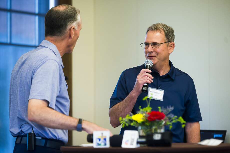 FILE — Dow CEO Jim Fitterling, left, chats with Currie Golf Course General Manager Paul Milholland, right, during a Media Day event for the upcoming Great Lakes Bay Invitational on Monday, June 24, 2019 at the Midland Country Club. (Katy Kildee/kkildee@mdn.net) Photo: (Katy Kildee/kkildee@mdn.net)