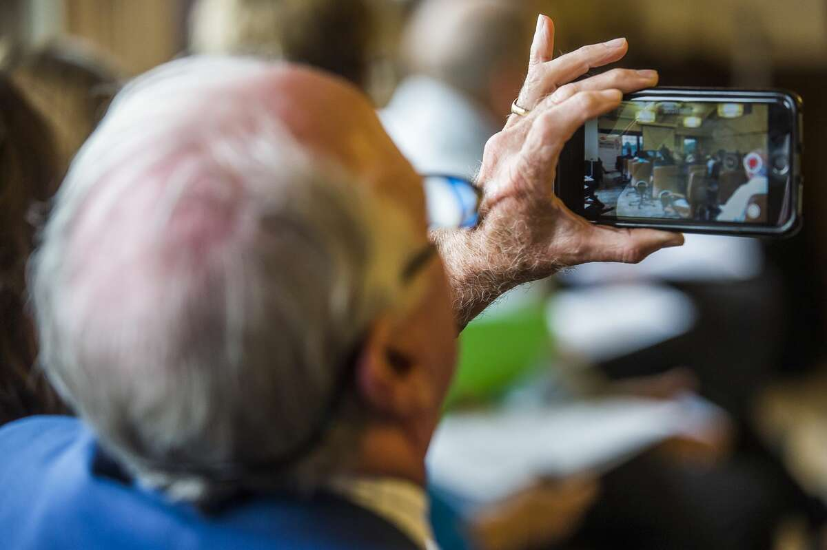 A guest records a video during a Media Day event for the upcoming Great Lakes Bay Invitational on Monday, June 24, 2019 at the Midland Country Club. (Katy Kildee/kkildee@mdn.net)