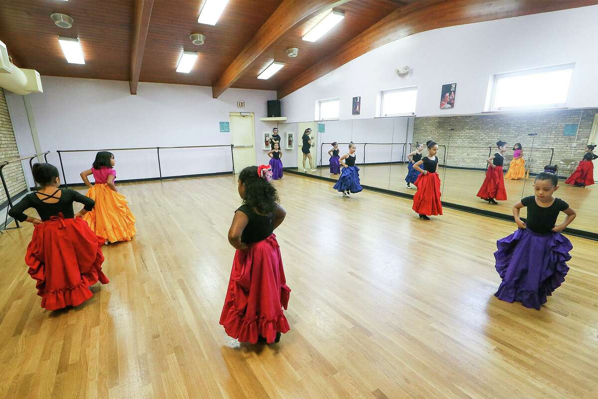 """Yirla Ayala leads a beginning folklorico dance class for 6- to 9-year-olds at the Berta Almaguer Dance Studio near the casting pond at Woodlawn Lake this month. Within these walls, instructors teach those """"wonderful things"""" that should be part of childhood."""