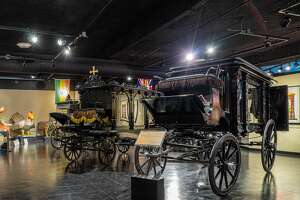 The National Museum of Funeral History is filled with artifacts of the rites of death including hearses, coffins and embalming tools.