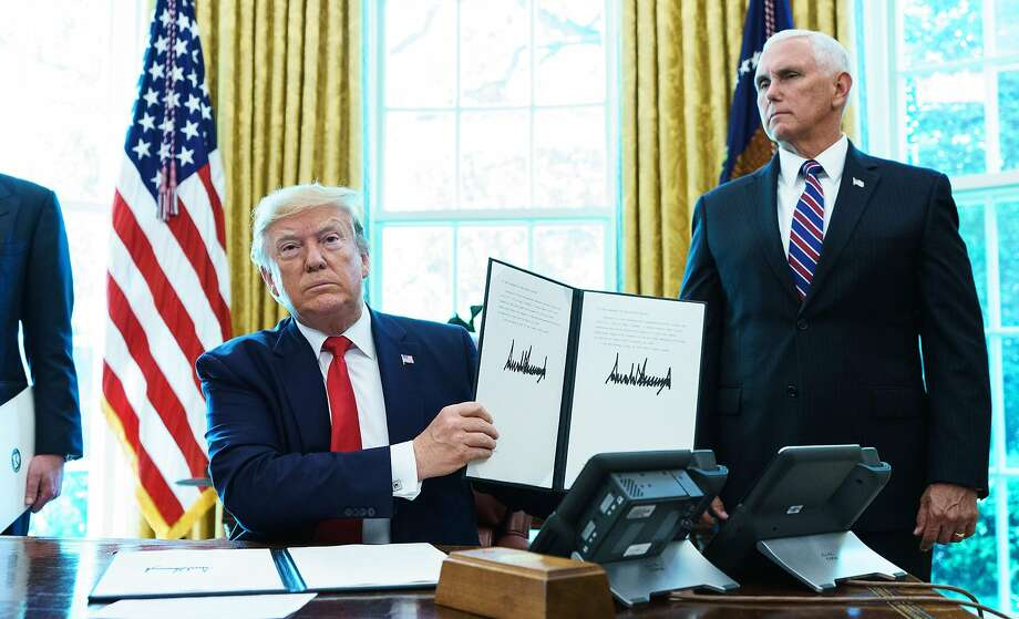 US President Donald Trump shows an executive order on sanctions on Iran's supreme leader in the Oval Office of the White House on June 24, 2019. (Photo by MANDEL NGAN / AFP)MANDEL NGAN/AFP/Getty Images Photo: MANDEL NGAN;Mandel Ngan / AFP / Getty Images