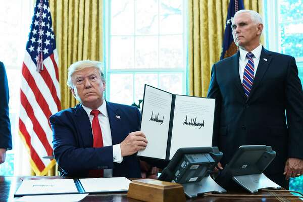 US President Donald Trump shows an executive order on sanctions on Iran's supreme leader in the Oval Office of the White House on June 24, 2019. (Photo by MANDEL NGAN / AFP)MANDEL NGAN/AFP/Getty Images