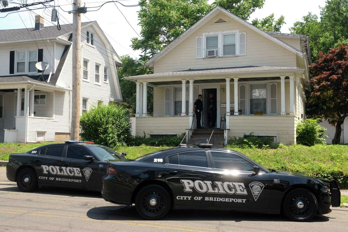 Police remained at the scene Monday afternoon on Bishop Ave., in Bridgeport, Conn. where a man was shot and killed in the early morning hours, June 24, 2019.