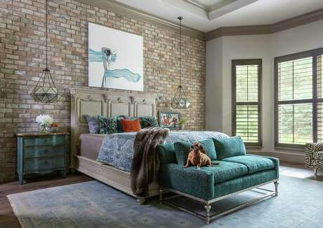 Shari and Randy Ziebarth had only been in their home for a couple of years when the Lake Conroe dam release during Hurricane Harvey left 43 inches of water in their home. Many of their repairs simply restored their home to what it was before, but some were upgrades, including this thin-format brick statement wall in the master bedroom.