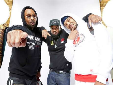 """Wu-Tang Clan members RZA, left, Ghostface Killah and Method Man, promoting the new documentary """"Wu-Tang Clan: Of Mics And Men."""""""