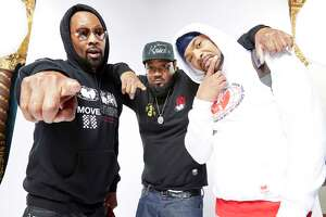 "Wu-Tang Clan members RZA, left, Ghostface Killah and Method Man, promoting the new documentary ""Wu-Tang Clan: Of Mics And Men."""