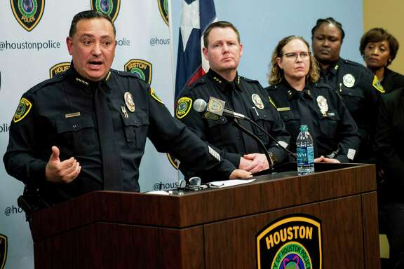 Houston Police Chief Art Acevedo, left, gives an update in the investigation of the officer-involved shooting, that left four HPD officers shot and two suspects dead, during a news conference Thursday, Jan. 31, 2019, in Houston.