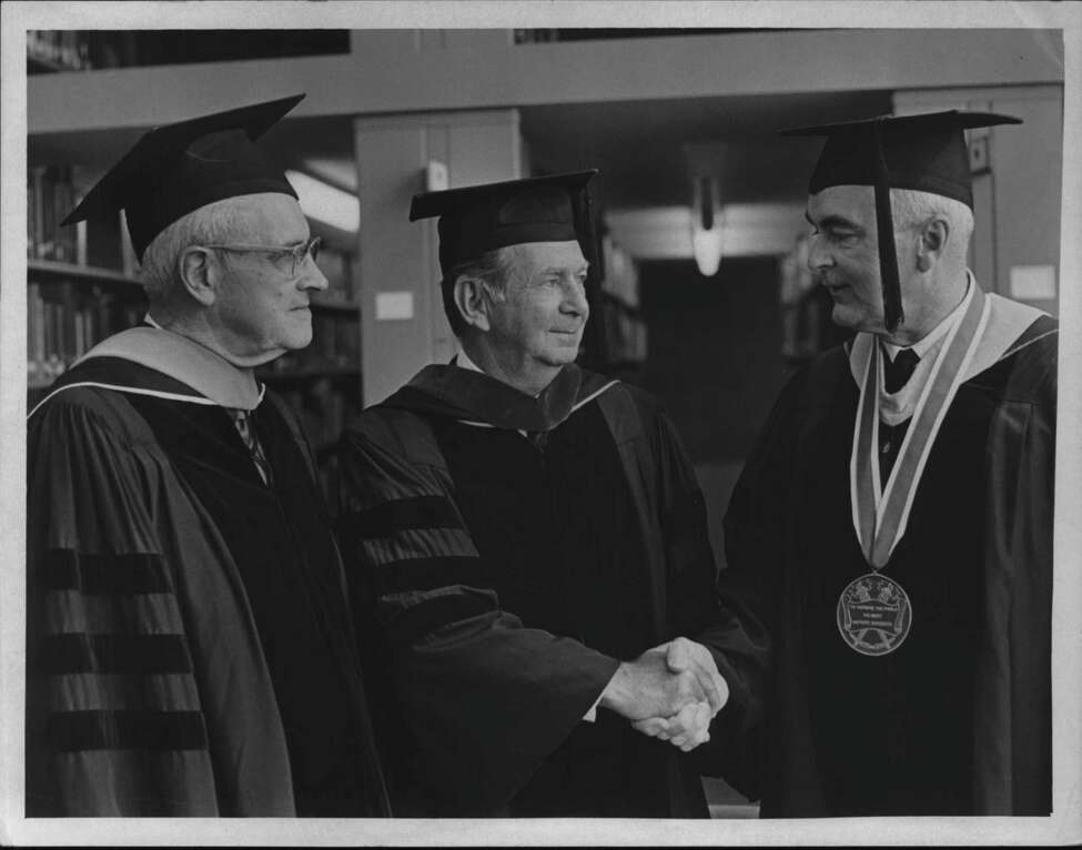 Lester C. Higbee, chairman, Board of Trustees; Sen. Earl W. Brydges, speaker; and James J. Fitzgibbons, president, during Hudson Valley Community College's 1969 commencement.