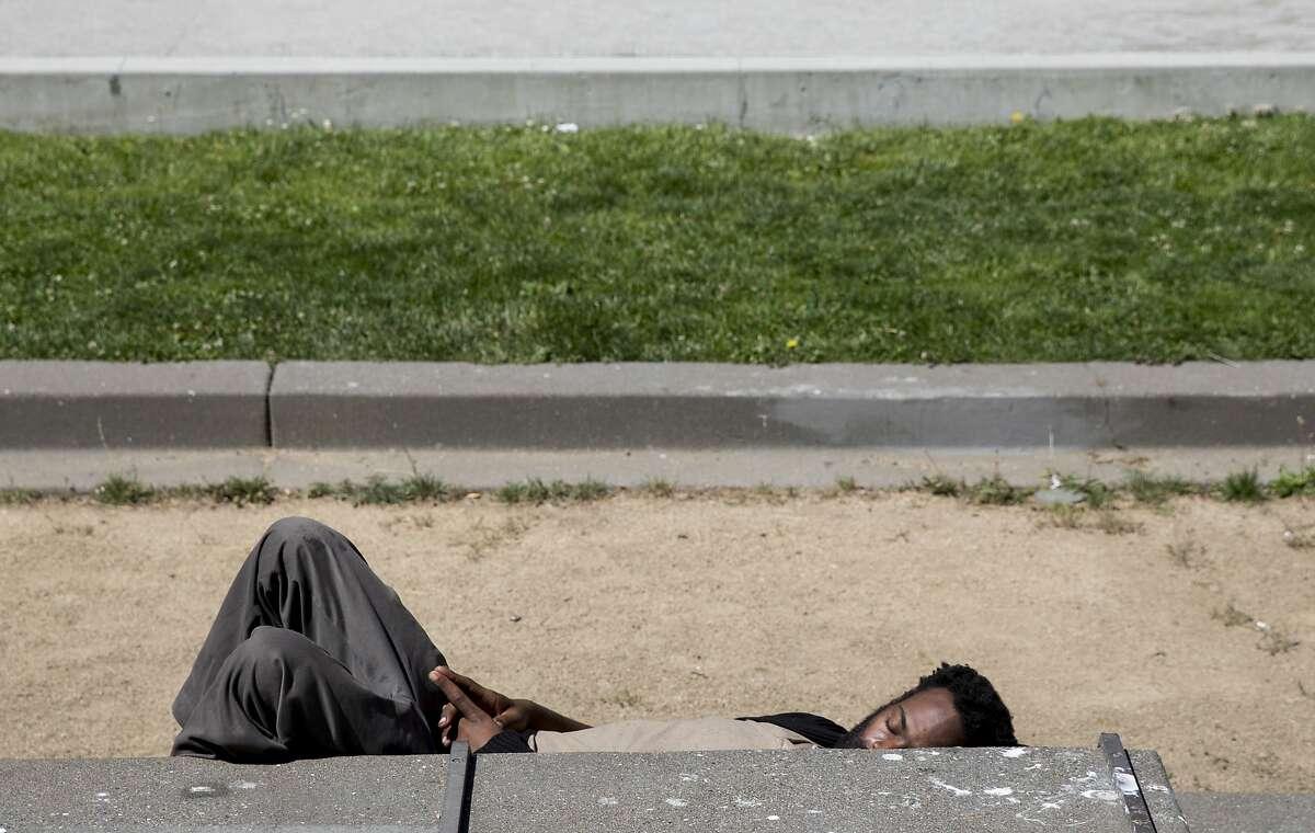 10:53 a.m. Embarcadero between Market Street and Don Chee Way A homeless man takes a nap along the Embarcadero on the south side of the Embarcadero Plaza in San Francisco, Calif. Tuesday, June 18, 2019.