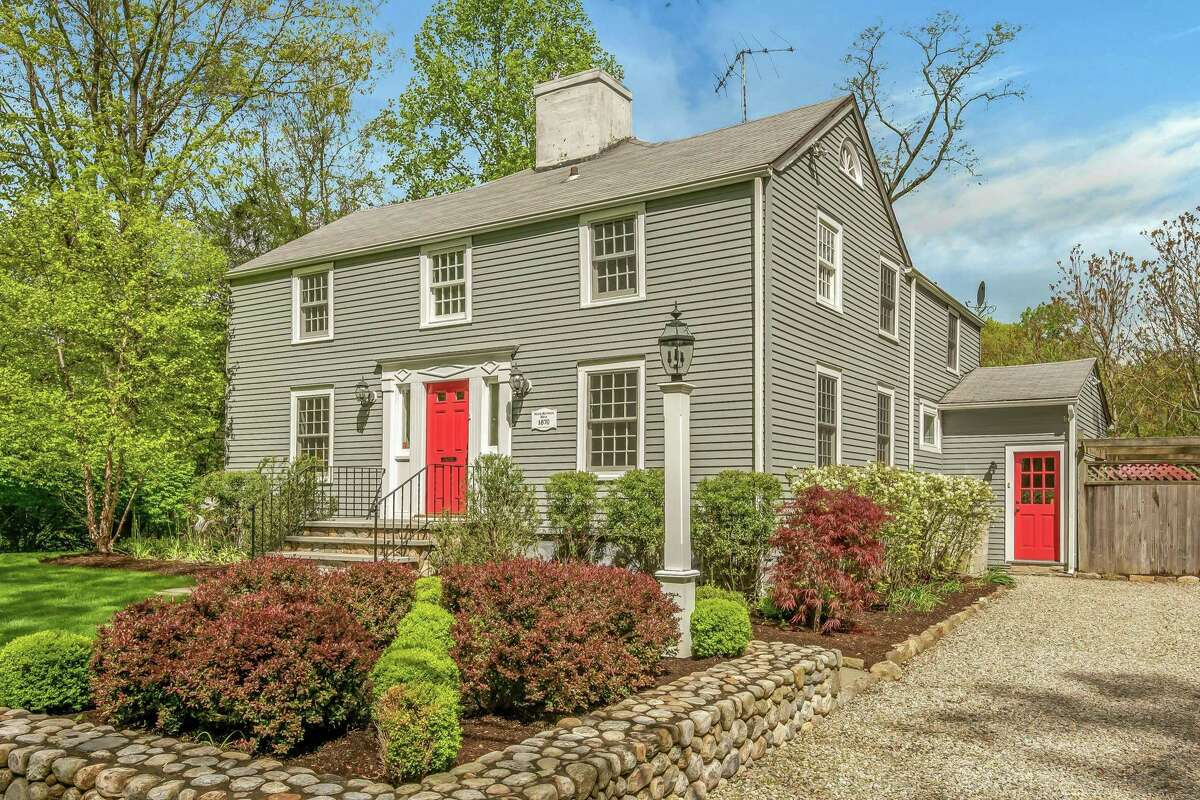 The gray updated antique colonial house at 69 Whitney Street is the oldest on its street dating back to 1870.