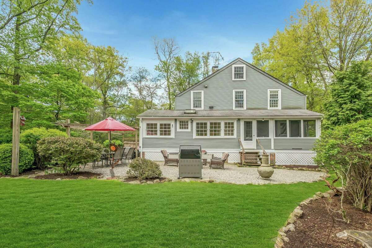 This eight-room house sits on a 1.14-acre level property, that has been professionally landscaped.