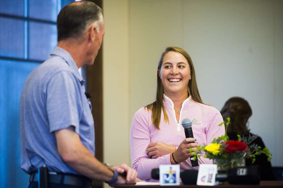 Jennifer Kupcho is introduced by Dow Inc. President and CEO Jim Fitterling during Monday's Media Day for the upcoming Dow Great Lakes Bay Invitational at the Midland Country Club. Kupcho made history earlier this year by becoming the first women ever to win an even at Augusta National Golf Club. Photo: Katykildee/kildee@mdn.net