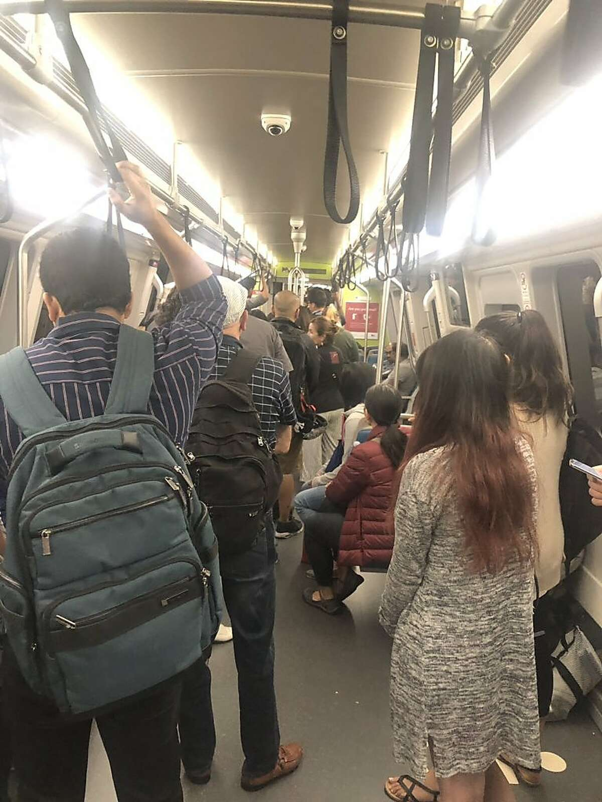 Passengers lined up in their train car before walking through the tunnel to the 12th Street Station after a train stalled Monday, June 25, 2019.