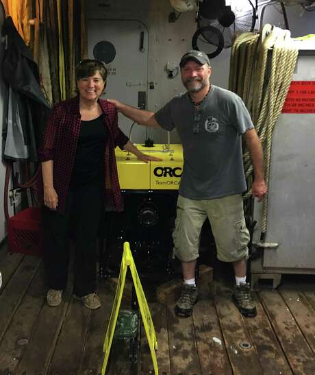 Edie Widder, left, and Dante Fenolio pose in this undated photo provided by Fenolio on June 24, 2019, with the Medusa underwater device that attracted a giant squid in the Gulf of Mexico. It was only the second research expedition to film a giant squid in its deepwater habitat, and the first giant squid to be filmed in the waters of the U.S. Fenolio is vice president of conservation research at the San Antonio Zoo.