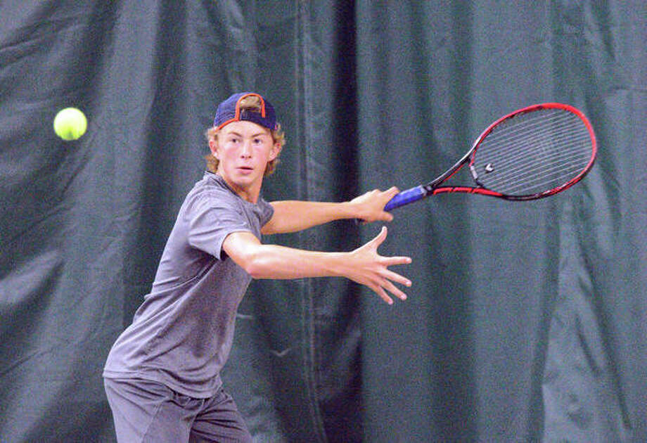 Colton Hulme makes a forehand return during his match against Michael Karibian on Sunday in the boys' 14 singles final of the Tiger Classic at the Edwardsville Meyer Center YMCA.