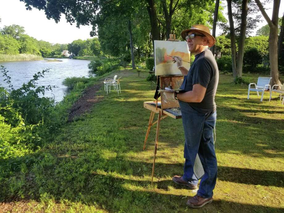 Dino Dalpazzlo works on his canvas during the paint out. Photo: John Hilsop / Contributed Photo