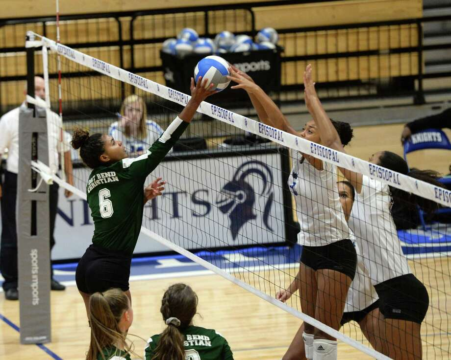 Cimone Woodard (9) of Episcopal blocks a shot being made by Zoee Granville (6) of Ft. Bend Christian in the third set of a high school volleyball match between the Ft. Bend Christian Eagles and the Episcopal Knights on August 17, 2018 at Episcopal High School, Bellaire, TX. Photo: Craig Moseley, Staff / Staff Photographer / ©2018 Houston Chronicle