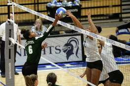 Cimone Woodard (9) of Episcopal blocks a shot being made by Zoee Granville (6) of Ft. Bend Christian in the third set of a high school volleyball match between the Ft. Bend Christian Eagles and the Episcopal Knights on August 17, 2018 at Episcopal High School, Bellaire, TX.