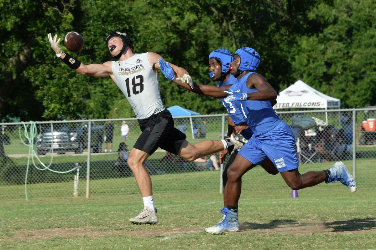 The Foster Falcons and the Dickinson Gators compete in the Cinco Ranch 7 on 7 State Qualifying Tournament on Friday, May 14, at Foster High School, Richmond, TX.