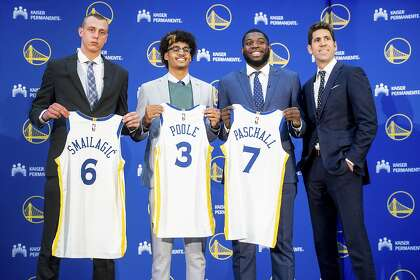Warriors GM a man of few words: Yes, he'll talk with Durant, Thompson