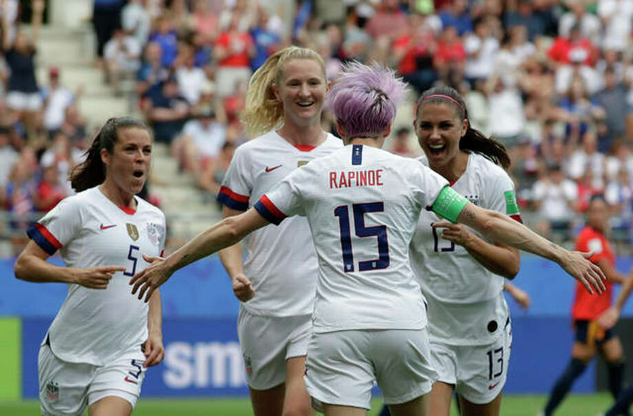 USA's Megan Rapinoe (15) celebrates with teammates Monday after scoring the opening goal from a penalty kick during the Women's World Cup round of 16 soccer match against Spain in Reims, France. Photo: Associated Press